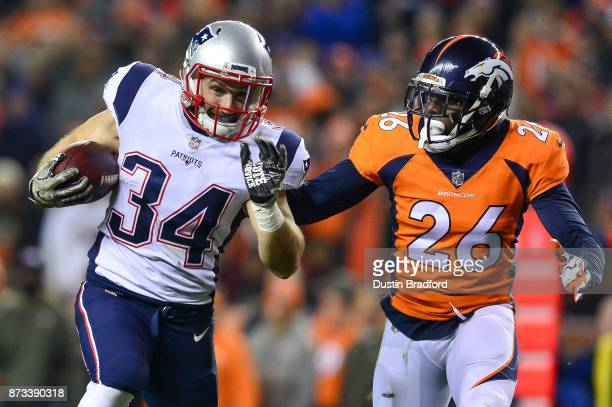Running back Rex Burkhead of the New England Patriots runs for a touchdown after a catch in the first quarter of a game as free safety Darian Stewart...