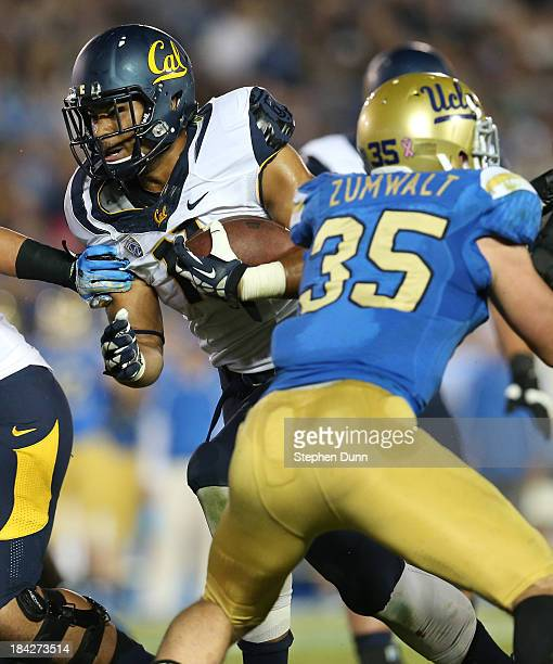 Running back Richard Rogers of the California Golden Bears carries the ball against the UCLA Bruins at the Rose Bowl on October 12 2013 in Pasadena...