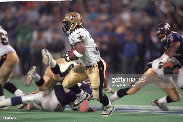 Running back Ricky Watters of the New Orleans Saints runs upfield against the Minnesota Vikings in the 2000 NFC Divisional Playoff Game at the...