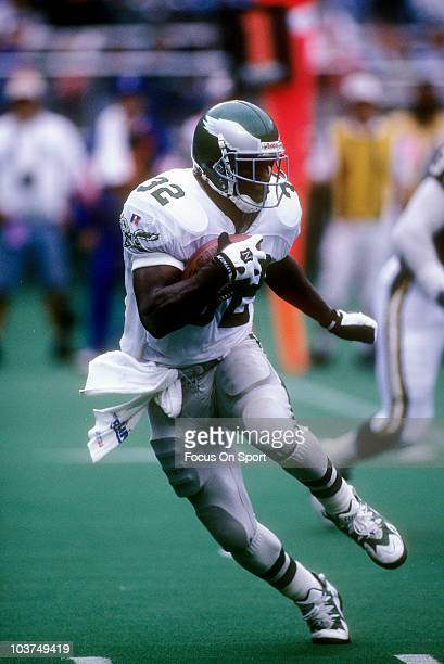 Running Back Ricky Watters of the Philadelphia Eagles carries the ball against the San Diego Chargers during an NFL football game September 17 1995...