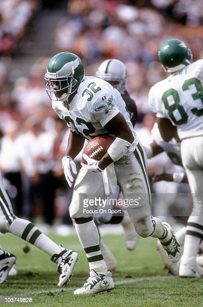 Running Back Ricky Watters of the Philadelphia Eagles carries the ball against the Oakland Raiders during an NFL football game September 24 1995 at...