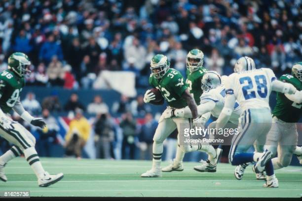 Running back Ricky Watters of the Philadelphia Eagles runs upfield against the Dallas Cowboys at Texas Stadium in the 1995 NFC Divisional Playoff...