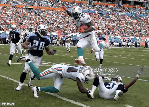 Running back Ricky Williams of the Miami Dolphins goes airborne for a first down against the Tennessee Titans in the second quarter on December 24,...