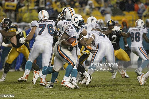 Running back Ricky Williams of the Miami Dolphins runs against the  Pittsburgh Steelers at Heinz Field ade8d1430