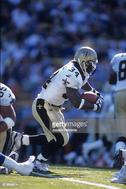 Running back Ricky Williams of the New Orleans Saints runs upfield against the Seattle Seahawks at Husky Stadium in Seattle Washington on Septemtber...