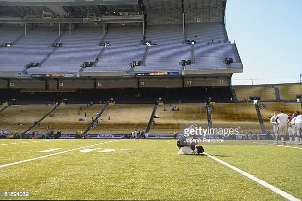 Running back Ricky Williams of the New Orleans Saints stretches prior to playing against the Seattle Seahawks at Husky Stadium in Seattle Washington...
