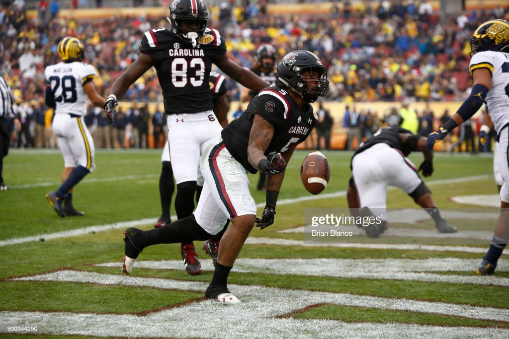 Running back Rico Dowdle #5 of the South Carolina Gamecocks celebrates in the end zone following his touchdown during the third quarter of the Outback Bowl NCAA college football game against the Michigan Wolverines on January 1, 2018 at Raymond James Stadium in Tampa, Florida.