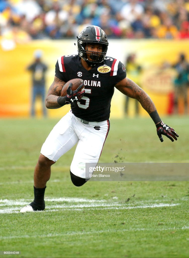 Running back Rico Dowdle #5 of the South Carolina Gamecocks runs for a first down during the third quarter of the Outback Bowl NCAA college football game against the Michigan Wolverines on January 1, 2018 at Raymond James Stadium in Tampa, Florida.