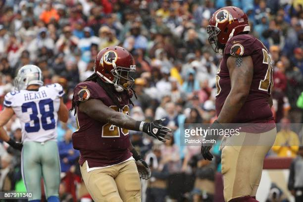 Running back Rob Kelley celebrates with offensive tackle Morgan Moses of the Washington Redskins after scoring a touchdown against the Dallas Cowboys...