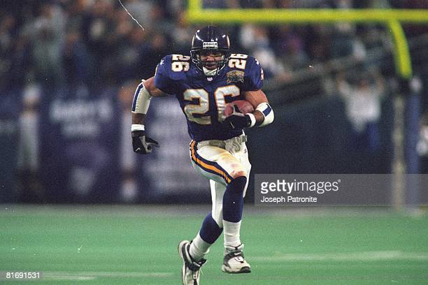 Running back Robert Smith of the Minnesota Vikings runs upfield against the New Orleans Saints in the 2000 NFC Divisional Playoff Game at the...