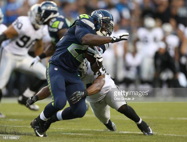 Running back Robert Turbin of the Seattle Seahawks rushes against the Oakland Raiders at CenturyLink Field on August 30 2012 in Seattle Washington