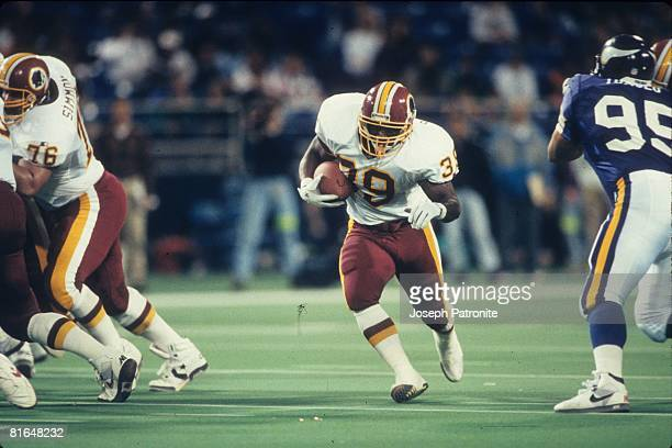 Running back Robet Green of the Washington Redskins runs upfield against the Minnesota Vikings in the 1992 NFC Wildcard Game at the Metrodome on...