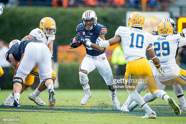 Running back Roc Thomas of the Auburn Tigers looks to maneuver by safety Maurice McKnight of the San Jose State Spartans on October 3 2015 at...