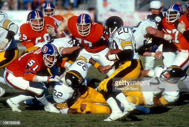 Running back Rocky Bleier of the Pittsburgh Steelers carries the ball against the Denver Broncos during an NFL football game at Mile High Stadium...