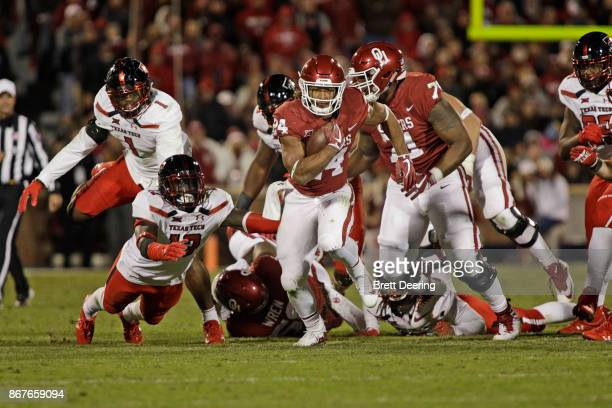 Running back Rodney Anderson of the Oklahoma Sooners accelerates after breaking through the Texas Tech Red Raiders line at Gaylord Family Oklahoma...