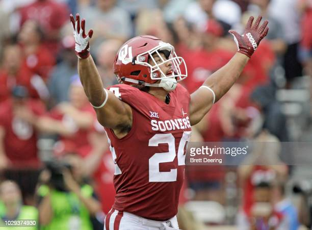 Running back Rodney Anderson of the Oklahoma Sooners celebrates a touchdown against the UCLA Bruins at Gaylord Family Oklahoma Memorial Stadium on...