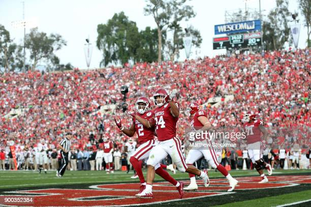 Running back Rodney Anderson of the Oklahoma Sooners celebrates after a 41yard touchdown run in the first half against the Georgia Bulldogs in the...