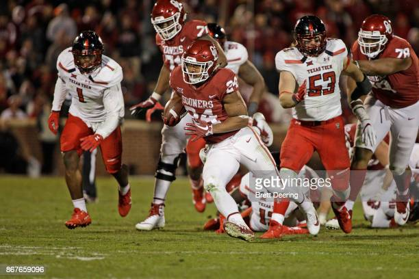 Running back Rodney Anderson of the Oklahoma Sooners cuts after breaking through the Texas Tech Red Raiders line at Gaylord Family Oklahoma Memorial...
