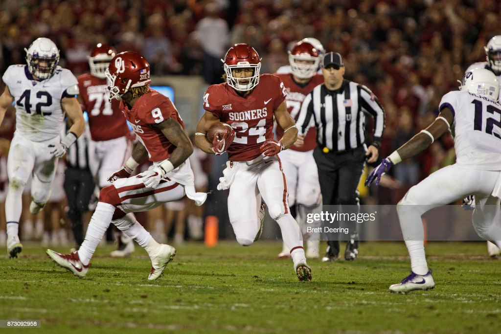 Running back Rodney Anderson #24 of the Oklahoma Sooners looks for a hole against the TCU Horned Frogs at Gaylord Family Oklahoma Memorial Stadium on November 11, 2017 in Norman, Oklahoma. Oklahoma defeated TCU