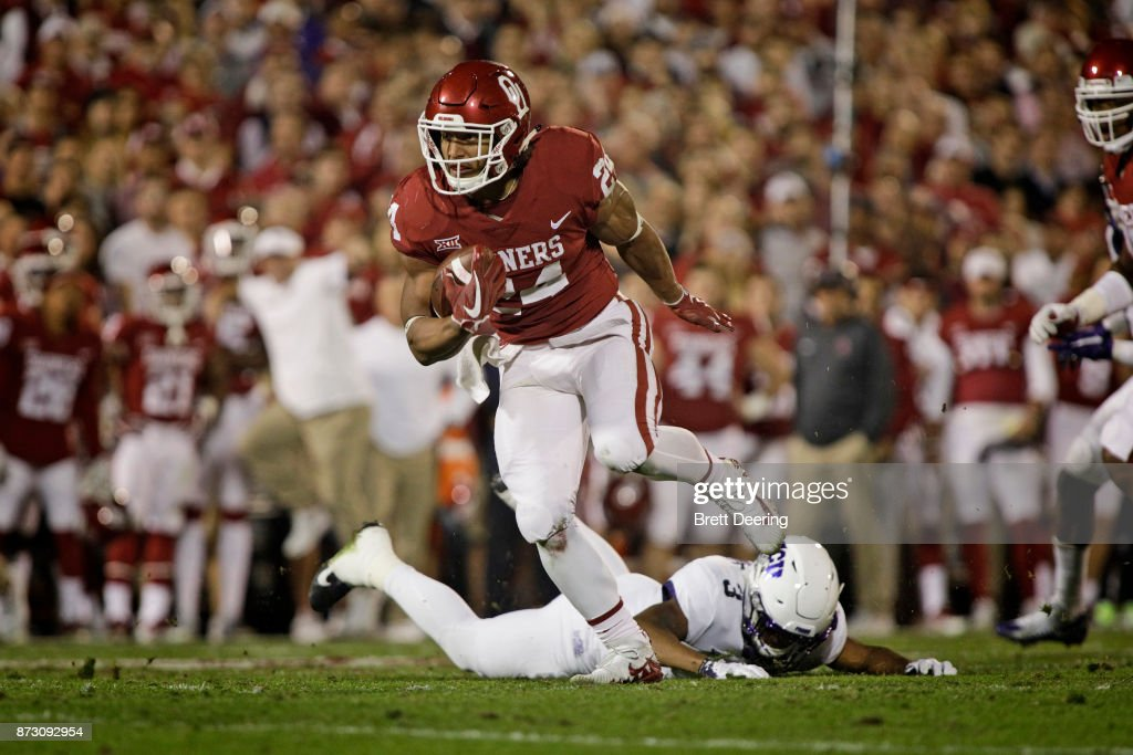 Running back Rodney Anderson #24 of the Oklahoma Sooners runs against the TCU Horned Frogs at Gaylord Family Oklahoma Memorial Stadium on November 11, 2017 in Norman, Oklahoma. Oklahoma defeated TCU