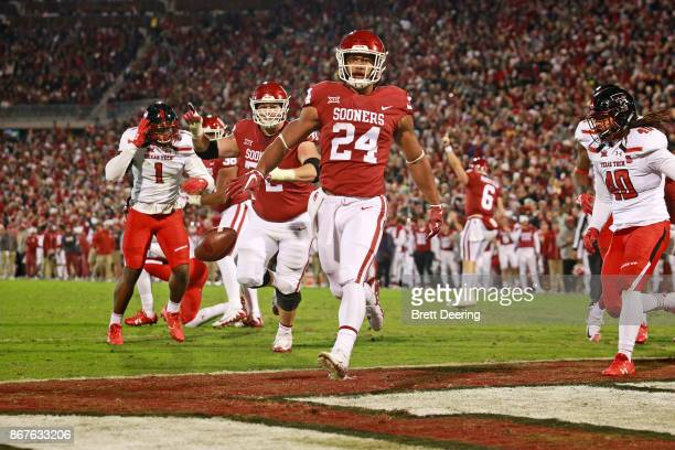 Running back Rodney Anderson of the Oklahoma Sooners scores against the Texas Tech Red Raiders at Gaylord Family Oklahoma Memorial Stadium on October...