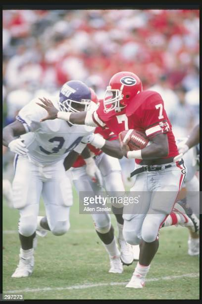 Running back Rodney Hampton of the Georgia Bulldogs stiff arms an opponent during a game against the Texas Christian Horned Frogs at Sanford Stadium...