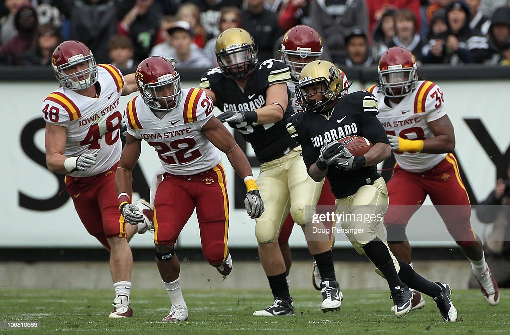 Running back Rodney Stewart #5 of the Colorado Buffaloes rushes for a first down as Jacob Lattimer #48, Ter'Ran Benton #22 and Roosevelt Maggit #38 of the Iowa State Cyclones pursue at Folsom Field on November 13, 2010 in Boulder, Colorado. Colorado defeated Iowa State 34-14.