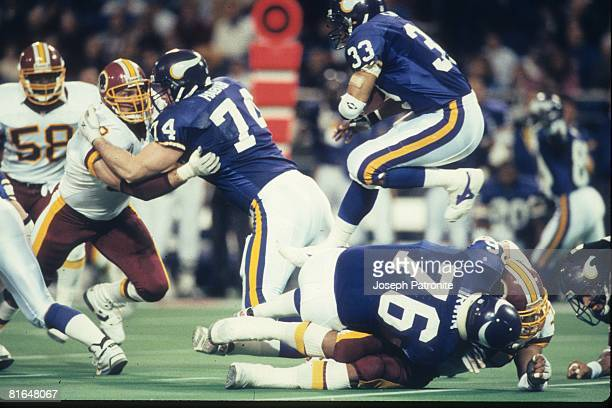 Running back Roger Craig of the Minnesota Vikings leaps over the block of tackle Tim Irwin against the Washington Redskins in the 1992 NFC Wildcard...