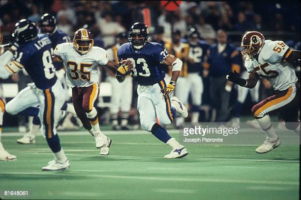 Running back Roger Craig of the Minnesota Vikings runs upfield against the Washington Redskins in the 1992 NFC Wildcard Game at the Metrodome on...