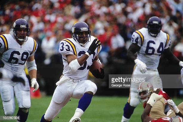 Running back Roger Craig of the Minnesota Vikings rushes for yards during the game against the San Francisco 49ers at Candlestick Park on October 3...