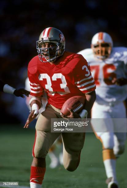 Running back Roger Craig of the San Francisco 49ers breaks away from the Tampa Bay Buccaneers defense during a game at Candlestick Park on November...