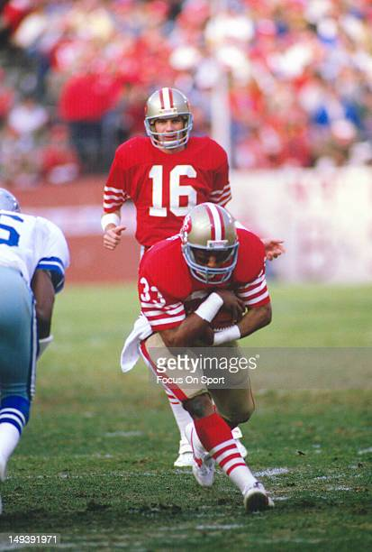 Running Back Roger Craig of the San Francisco 49ers carries the ball against the Dallas Cowboys during an NFL football game December 22 1985 at...