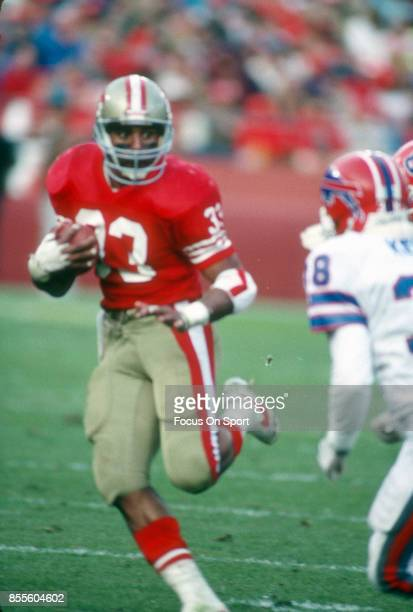 Running Back Roger Craig of the San Francisco 49ers carries the ball against the Buffalo Bills during an NFL football game December 17 1989 at...