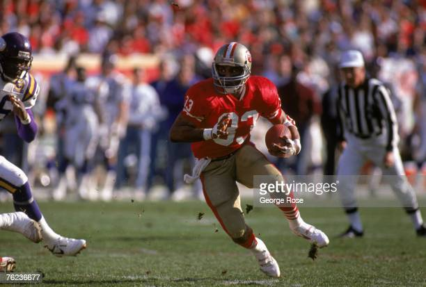 Running back Roger Craig of the San Francisco 49ers finds room to run against the Minnesota Vikings during the 1989 NFC Divisional Playoffs at...