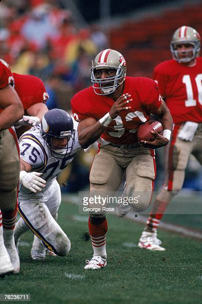 Running back Roger Craig of the San Francisco 49ers finds room to run against the Minnesota Vikings defense during the 1987 NFC Divisional Playoffs...