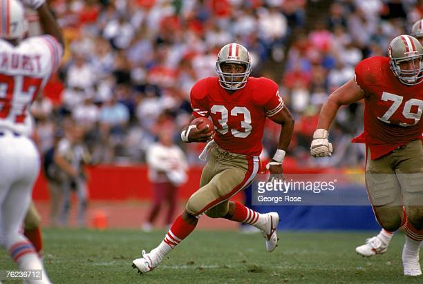 Running back Roger Craig of the San Francisco 49ers looks for room to run against the New England Patriots defense during a game at Candlestick Park...