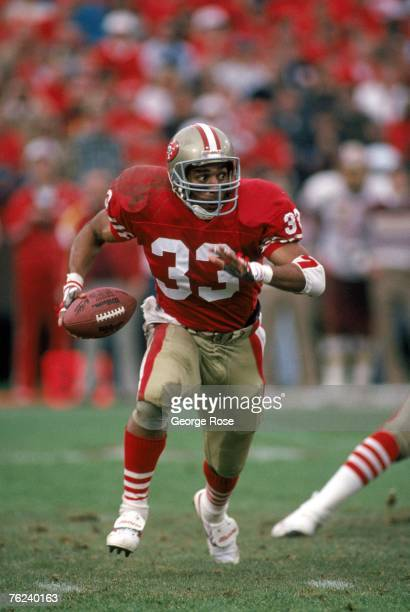 Running back Roger Craig of the San Francisco 49ers looks for room to run during the 1990 NFC Divisional Playoff game against the Washington Redskins...