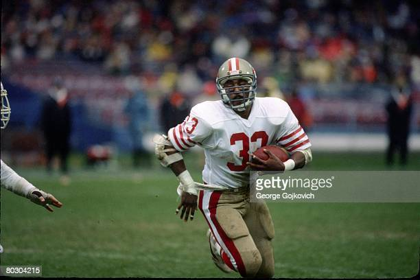 Running back Roger Craig of the San Francisco 49ers runs the football against the Cleveland Browns at Municipal Stadium on November 11 1984 in...
