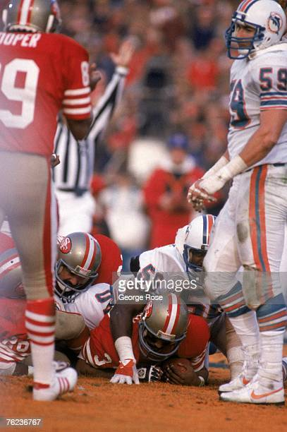 Running back Roger Craig of the San Francisco 49ers scores a touchdown on a two yard run behinds teammates Wendell Tyler and Russ Francis in the...