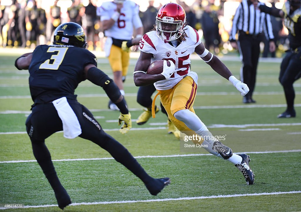 Running back Ronald Jones II #25 of the USC Trojans runs for a touchdown as safety Tyree Robinson #3 of the Oregon Ducks tries to tackle him during the third quarter of the game at Autzen Stadium on November 21, 2015 in Eugene, Oregon. The Ducks won the game 48-28.