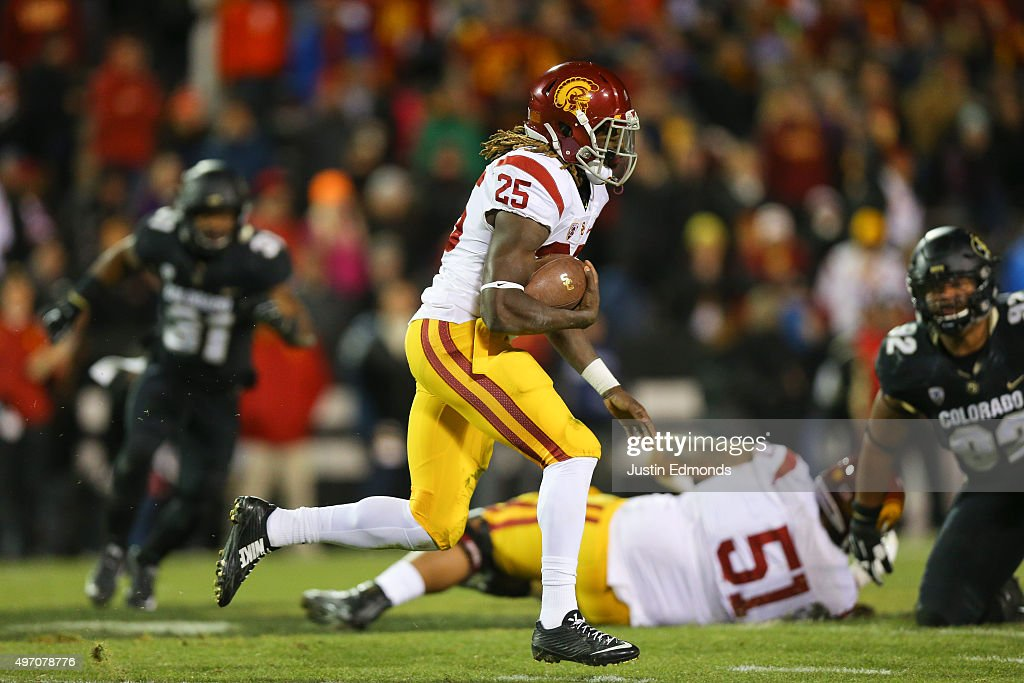 Running back Ronald Jones II #25 of the USC Trojans runs with the ball during the first quarter against the Colorado Buffaloes at Folsom Field on November 13, 2015 in Boulder, Colorado.
