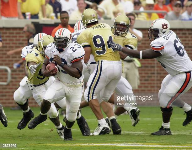 Running back Ronnie Brown of the Auburn Tigers runs past the out stretched arms of linebacker Keyaron Fox of the Georgia Tech Yellow Jackets during...