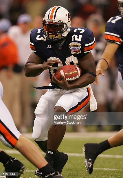 Running back Ronnie Brown of the Auburn Tigers runs with the ball against the Virginia Tech Hokies during the Nokia Sugar Bowl on January 3 2005 at...