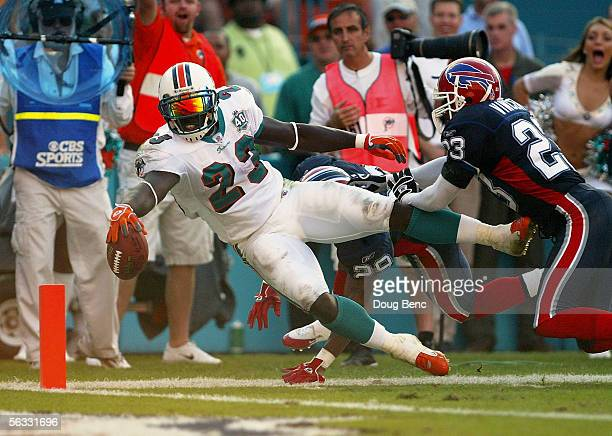 Running back Ronnie Brown of the Miami Dolphins lunges for the endzone after catching touchdown pass from quarterback Sage Rosenfels in the fourth...