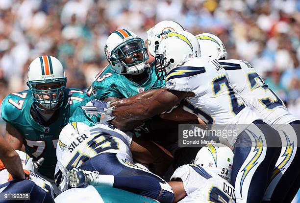 Running back Ronnie Brown of the Miami Dolphins runs with the ball against the San Diego Chargers at Qualcomm Stadium on September 27 2009 in San...