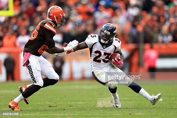 Running back Ronnie Hillman of the Denver Broncos looks get around cornerback Pierre Desir of the Cleveland Browns during the fourth quarter at...