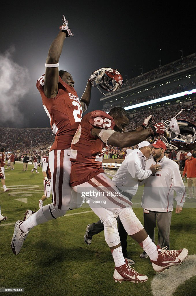 Running back Roy Finch #22, right, and defensive back Cortez Johnson #22 of the Oklahoma Sooners celebrate after the game against the Texas Tech Red Raiders October 26, 2013 at Gaylord Family-Oklahoma Memorial Stadium in Norman, Oklahoma. Oklahoma defeated Texas Tech 38-30.