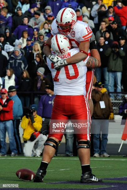 Running back Roy Helu Jr #10 celebrates with teammate Matt Slauson of the Nebraska Cornhuskers after scoring a touchdown against the Kansas State...