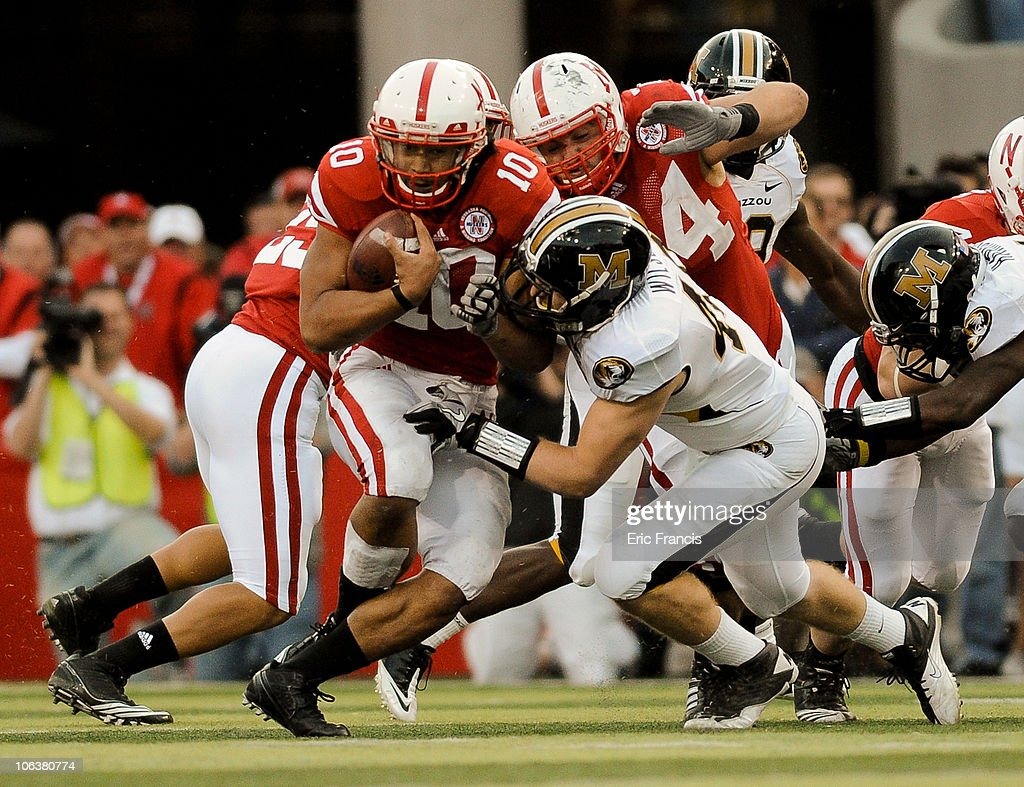 Running back Roy Helu Jr. #10 of the Nebraska Cornhuskers slipped through the grasp of Andrew Wilson #48 Missouri Tigers Defense during second half action of their game at Memorial Stadium on October 30, 2010 in Lincoln, Nebraska. Nebraska Defeated Missouri 31-17.
