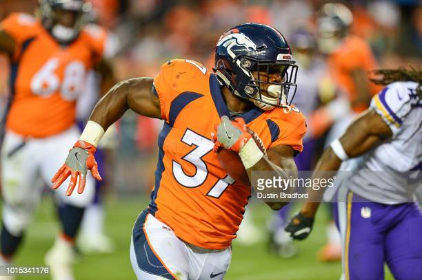 Running back Royce Freeman of the Denver Broncos carries for a 23 yard second quarter touchdown against the Minnesota Vikings during an NFL preseason...